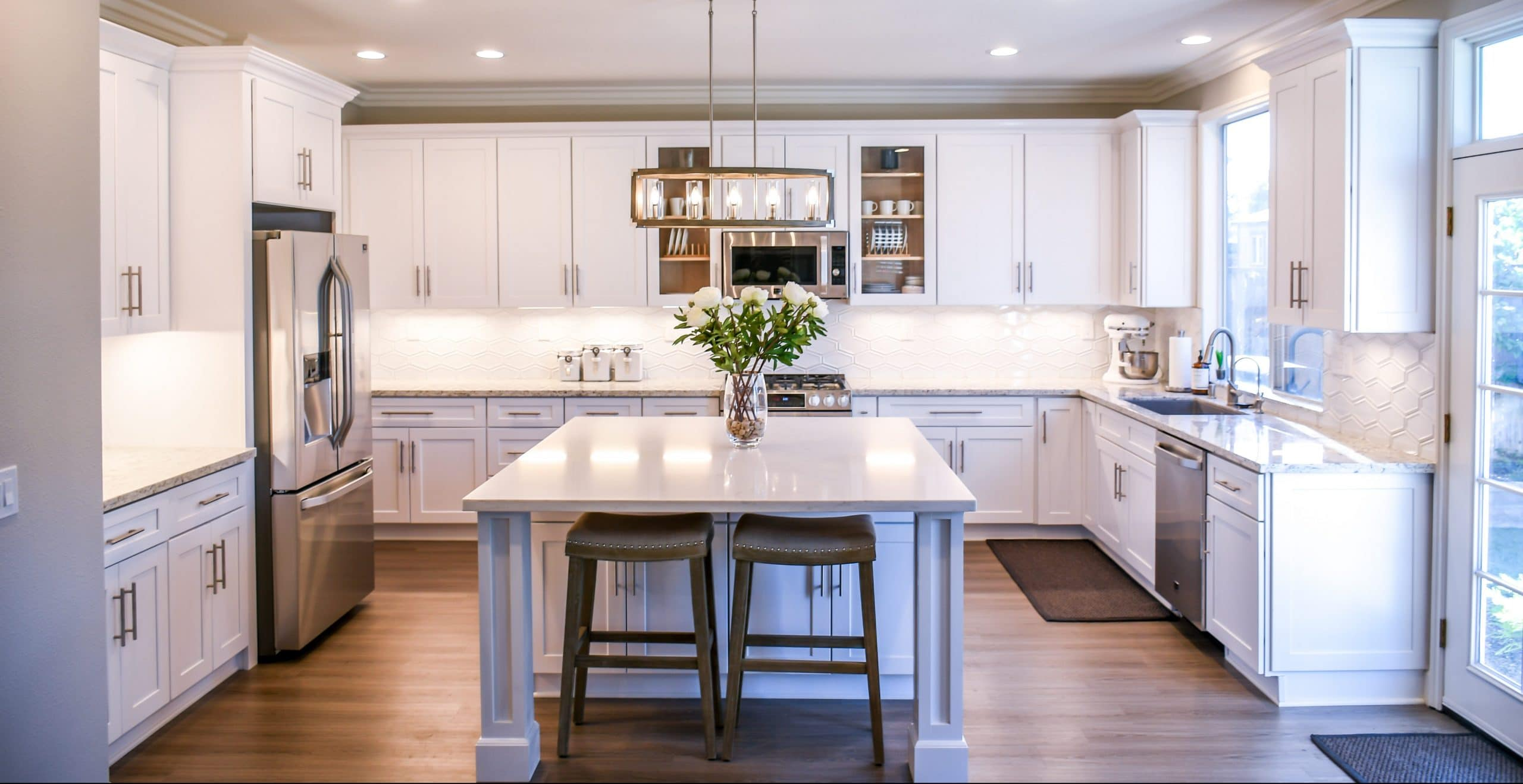 white painted kitchen with elaborate columns