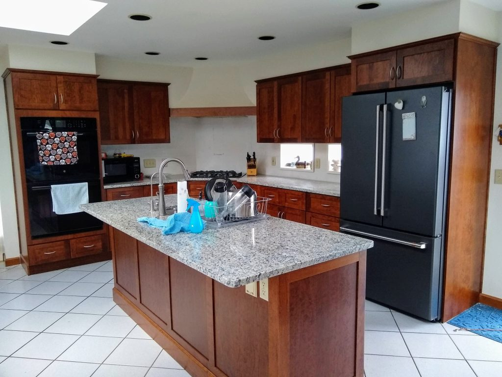 refaced cherry kitchen with concealed soft closed hinges